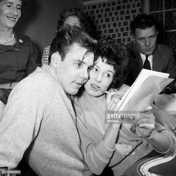 Rock 'n' Roll singer Marty Wilde and his fiance Joyce Baker making last minute arrangements at the home of Marty's parents in Greenwich ahead of...