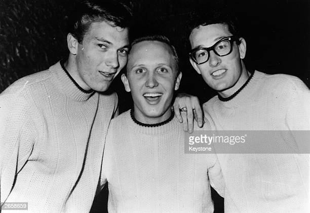 Rock 'n' roll singer songwriter and guitarist Buddy Holly right with his group The Crickets Jerry Allison and Joe Mauldin