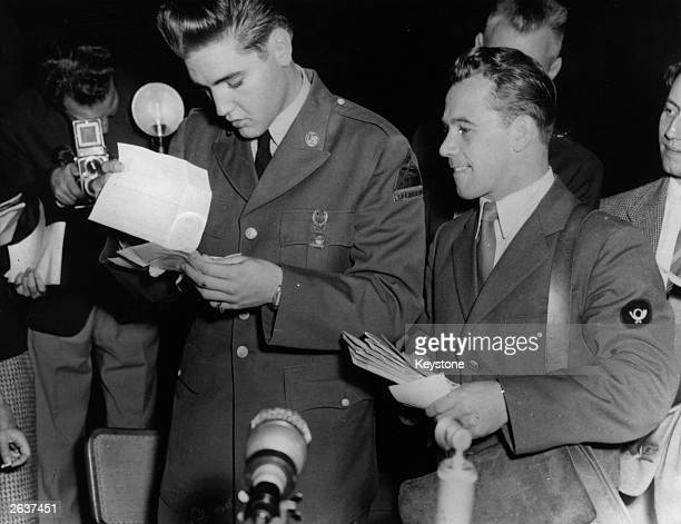Rock 'n' roll star Elvis Presley , now a GI, receives his first bundle of mail at the Friedberg US Army base in Germany, where he will serve sixteen...