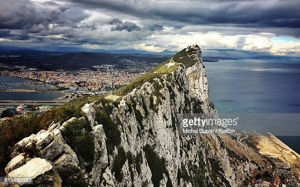 rock of gibraltar against cloudy storm sky - rock of gibraltar stock photos and pictures