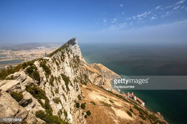 rock of gibraltar on a clear sunny day. a long standing area of  disagreement over sovereignty between great britain and spain, and a brexit battle over who will have final sovereignty over this area. - rock of gibraltar stock photos and pictures