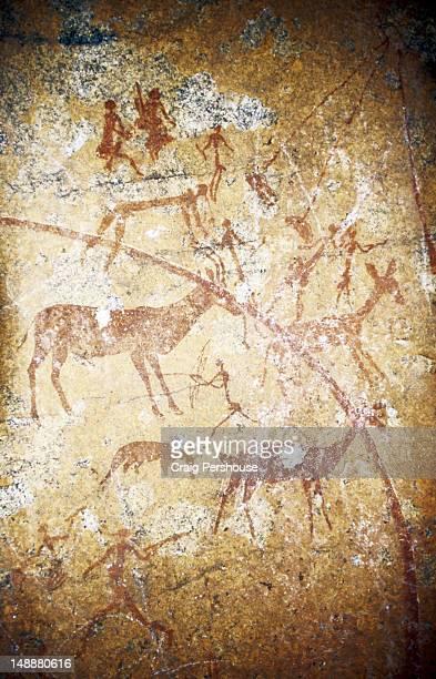Rock painting of bushmen and antelopes.