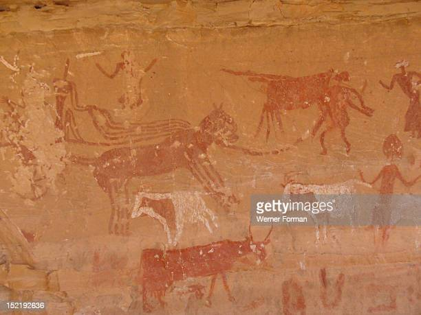 Rock painting with scene of everyday life from the Horse Phase The depictions of flying chariots are though to be suggestive of the first caravan...