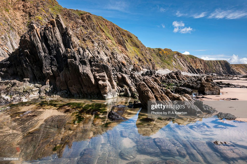 Rock pools at Marloes sands : Stock-Foto