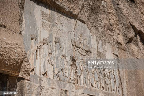 rock relief of bisotun (bisutun, behistun), including a message from darius the great in cuneiform script, zagros mountains, kermanshah province, iran - foot bone stock pictures, royalty-free photos & images