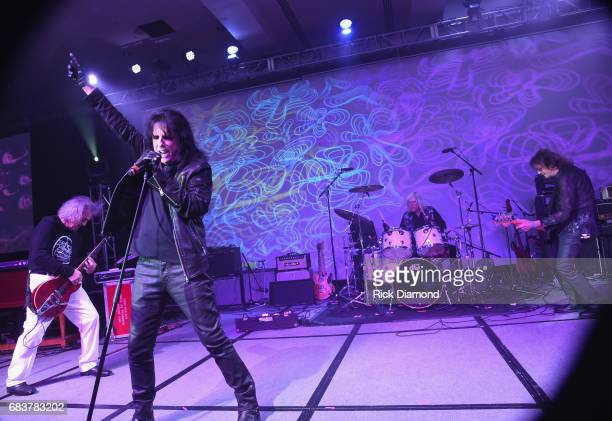 Rock Roll Hall of Fame Singer/Songwriter Alice Cooper performs with original band members Michael Bruce Neal Smith and Dennis Dunaway during Music...