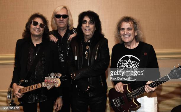 Rock Roll Hall of Fame Singer/Songwriter Alice Cooper with original band members Dennis Dunaway Neal Smith and Michael Bruce backstage during Music...