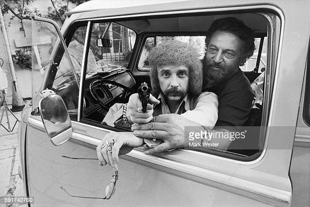 Rock Roll songwriter and record producer Phil Spector points a gun as his bodyguard a former US Marshall assists him in 1975 On February 3 Phil...