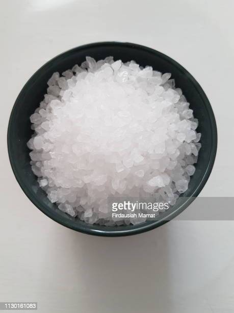 rock salt isolated against white background - salt mineral stock pictures, royalty-free photos & images