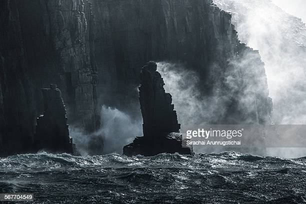 Rock sea stacks with sea spray