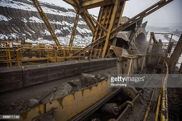 Rock sediment moves up a conveyor belt on a giant excavator during the mining of brown coal at the Bilina open pit lignite mine operated by...
