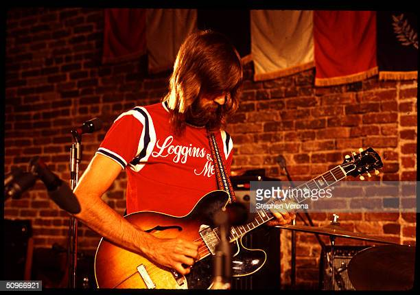 Rock singer and musician Kenny Loggins of Loggins and Messina performs a guitar solo on a small stage on June 10 1972 in San Francisco California