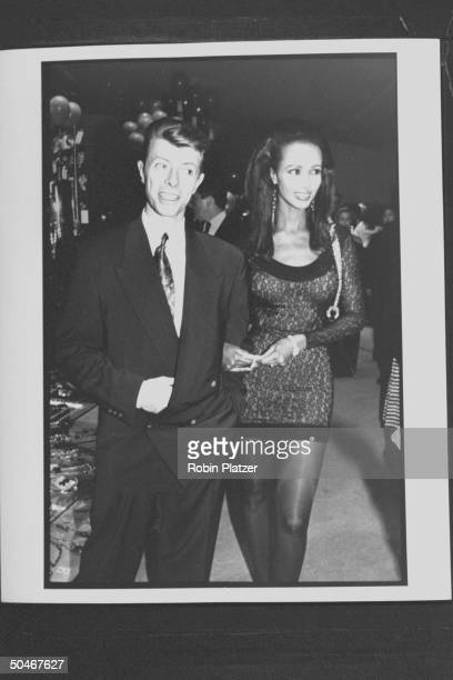 Rock singer David Bowie w model Iman at 7th Ave on Sale AIDS benefit
