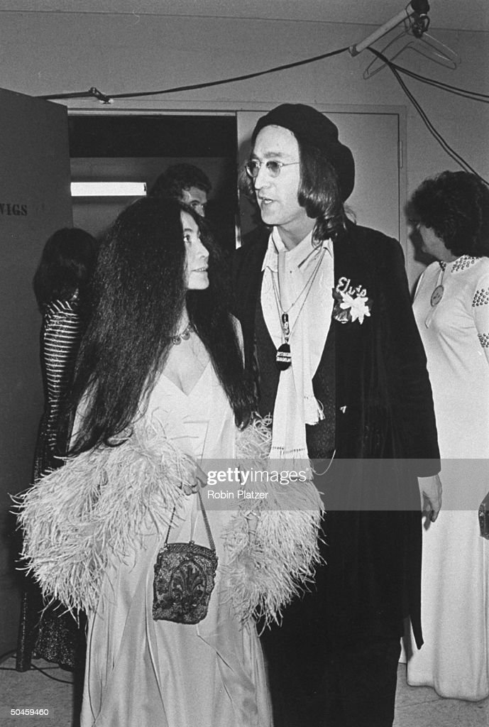 Rock singer John Lennon with wife Yoko Ono backstage at the Grammy Awards. Probably Los Angeles.
