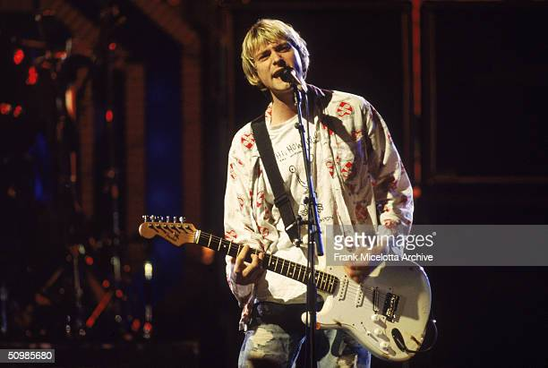 Rock singer Kurt Cobain performs on stage with Nirvana at the MTV Video Music Awards, September 10, 1992.