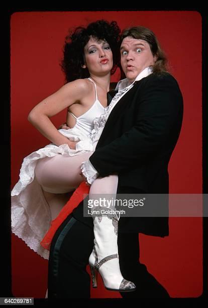 Rock singer Meat Loaf holds his backup singer Karla DeVito