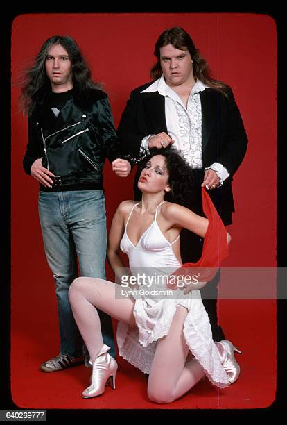 Rock singer Meat Loaf poses with singer Karla DeVito and a band member