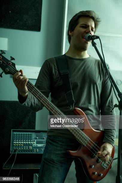 rock singer performing in the rehearsal studio - modern rock stock pictures, royalty-free photos & images