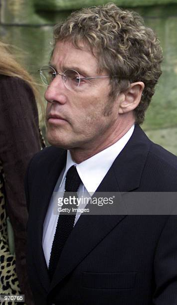 Rock singer Roger Daltre arrives for his funeral service at St Edwards Church July 10 2002 in StowontheWold United Kingdom Entwistle bass player for...
