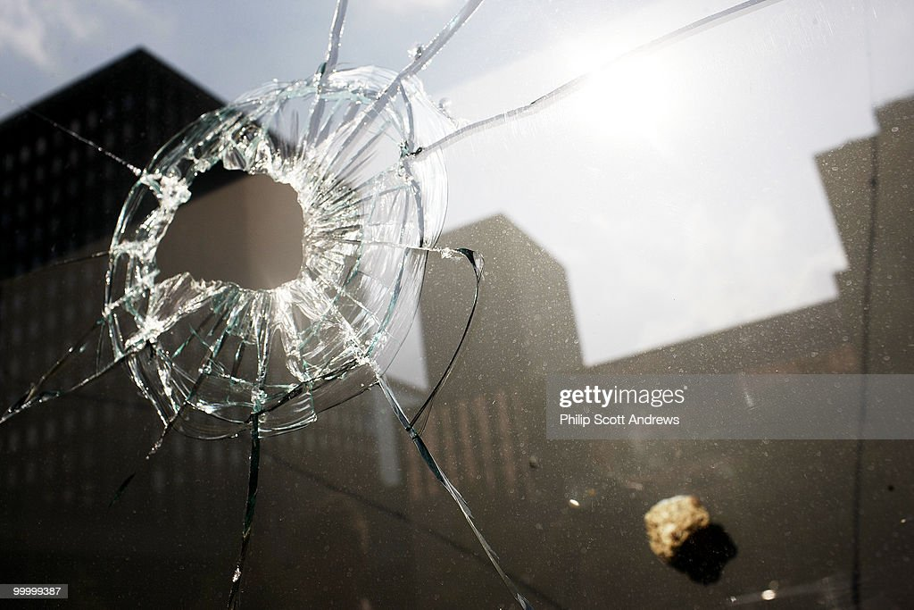 A rock sits lodged in the back wall of a display case at the downtown Macy's store. Some of the demonstrators that moved through here broke windows in storefronts and police cars.