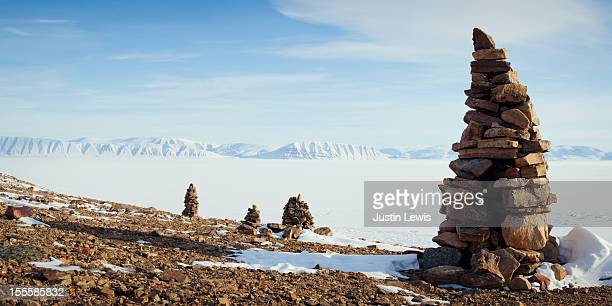 Rock stacks with snowy expanse and mountains