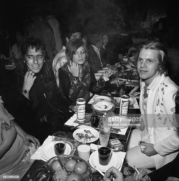 Rock star Alice Cooper and friends celebrate an early Thanksgiving at the Troubadour on November 21, 1973 in Los Angeles, California.