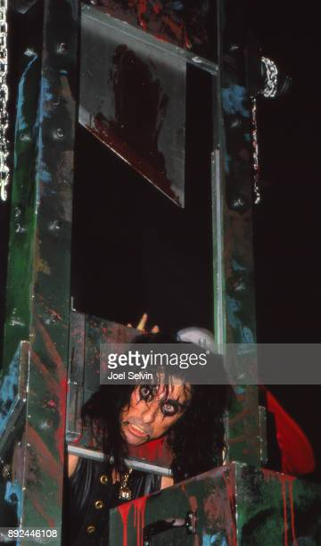Rock star Alice Cooper poses with trademark guillotine at the Cow Palace in circa 1979 in San Francisco California