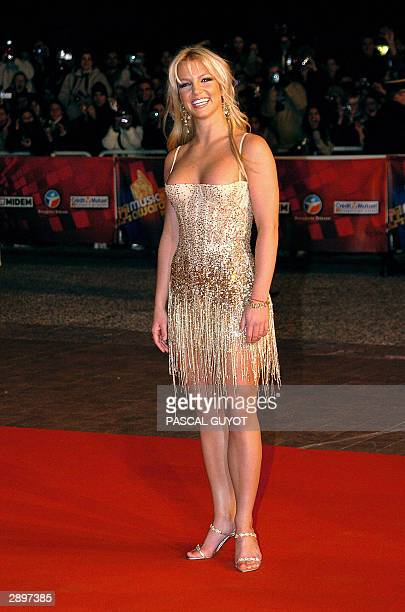 Rock star Britney Spears arrives 24 January 2004 at Cannes' Palais des Festivals, for France's annual NRJ music awards. The awards are held as the...