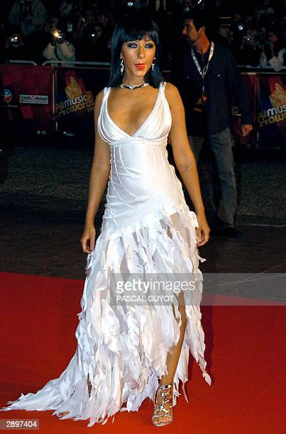 US rock star Christine Aguilera arrives 24 January 2004 at Cannes' Palais des Festivals for France's annual NRJ music awards The awards are held as...