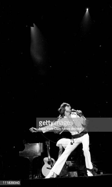 Rock star David Cassidy in concert at Madison Square Garden Keeping everything moving David gets most out of skintight white jump suit