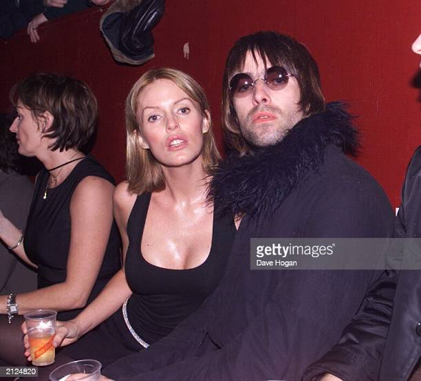Rock star Liam Gallagher of Oasis and his wife actress Patsy Kensit attend a concert by The Who at SHepherd's Bush Empire London on December 22 1999