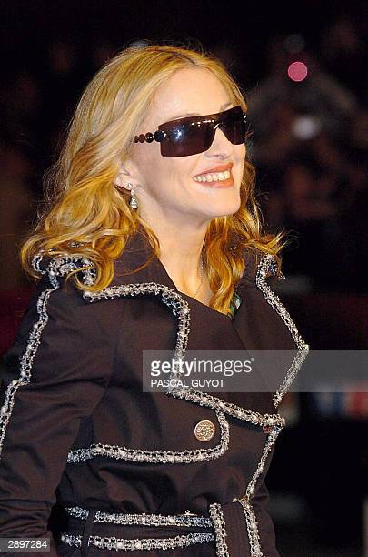 US rock star Madonna arrives 24 January 2004 at Cannes' Palais des Festivals for France's annual NRJ music awards The awards are held as the...