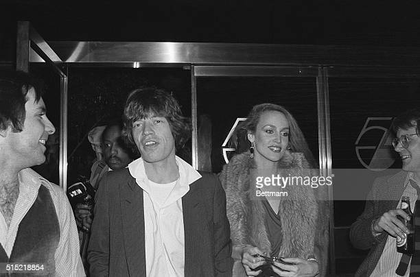 """Rock star Mick Jagger and his future wife, model Jerri Hall, arrive at Studio 54 to attend an """"Oscar"""" party at the disco club."""