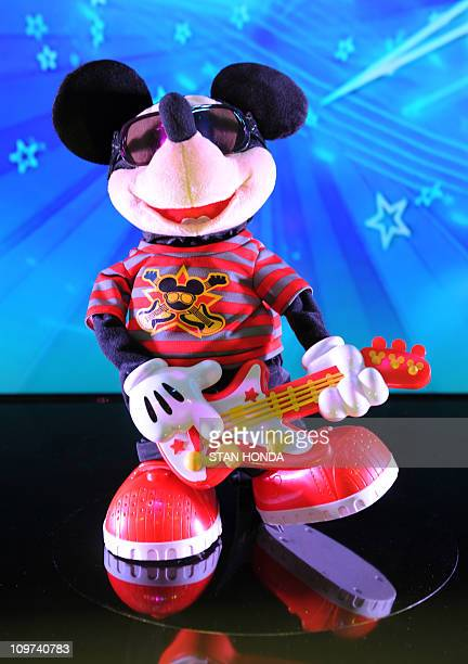 'Rock Star Mickey' by FisherPrice a guitarplaying toy based on the Mickey Mouse character on display at the Toy Fair 2011 February 15 2011 at the...