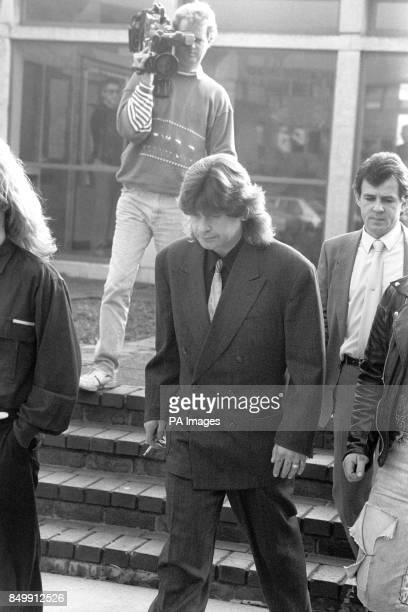 Rock star Ozzy Osbourne on his way to Amersham Magistrates Court in Buckinghamshire followed by television cameraman Mr O'Donahue who was given a...