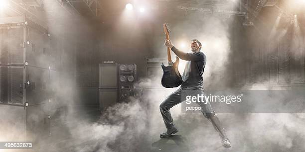 rock star - guitarist stock pictures, royalty-free photos & images