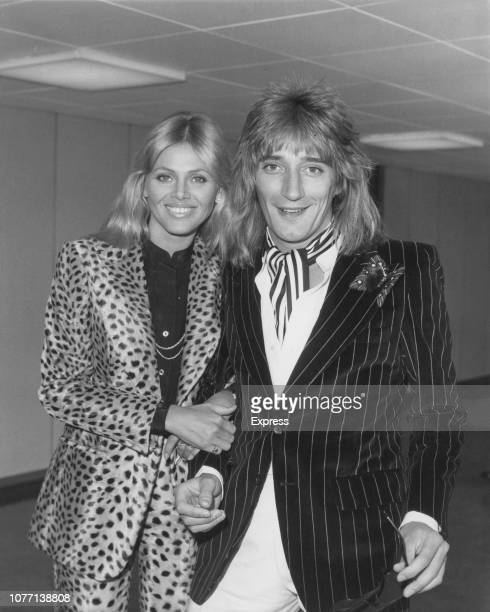 Rock star Rod Stewart and his partner, actress Britt Ekland arrive at London's Heathrow Airport from America, 29th April 1976. A tax exile from...