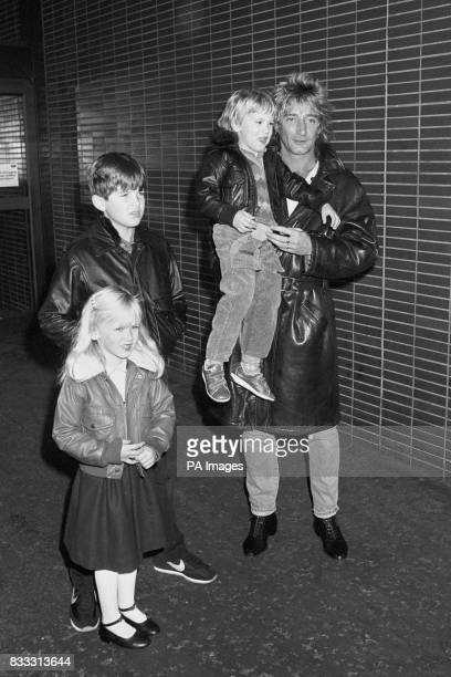 Rock star Rod Stewart with his son Sean daughter Kimberly 4 and his wife Alan's 9 year old son Ashley by her previous marriage at Heathrow Airport