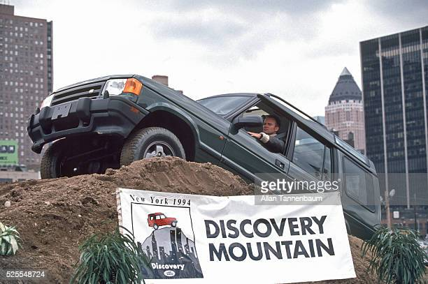Rock Star Sting drives a Land Rover over an obstacle course to promote the new Discovery model, New York, New York, March 30, 1994.