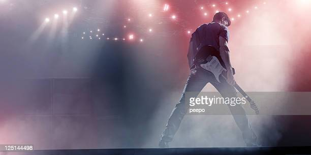 rock star with guitar - performing arts event stock pictures, royalty-free photos & images
