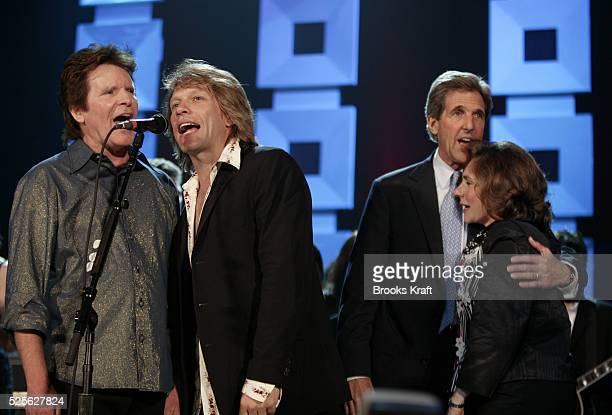 Rock stars Bon Jovi and John Fogerty sing for Democratic Presidential nominee Senator John Kerry and his wife Teresa during a political benefit...