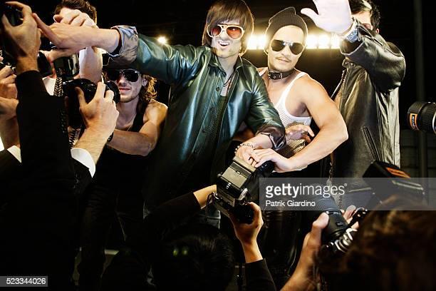 Rock Stars Fighting Off Paparazzi