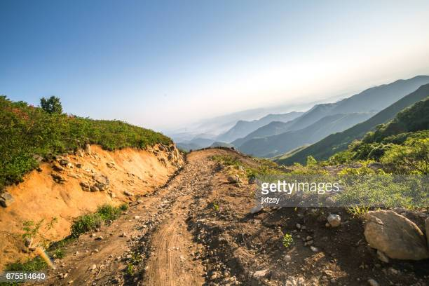 rock stone road in sunrise with tire imprint for automobile commercial