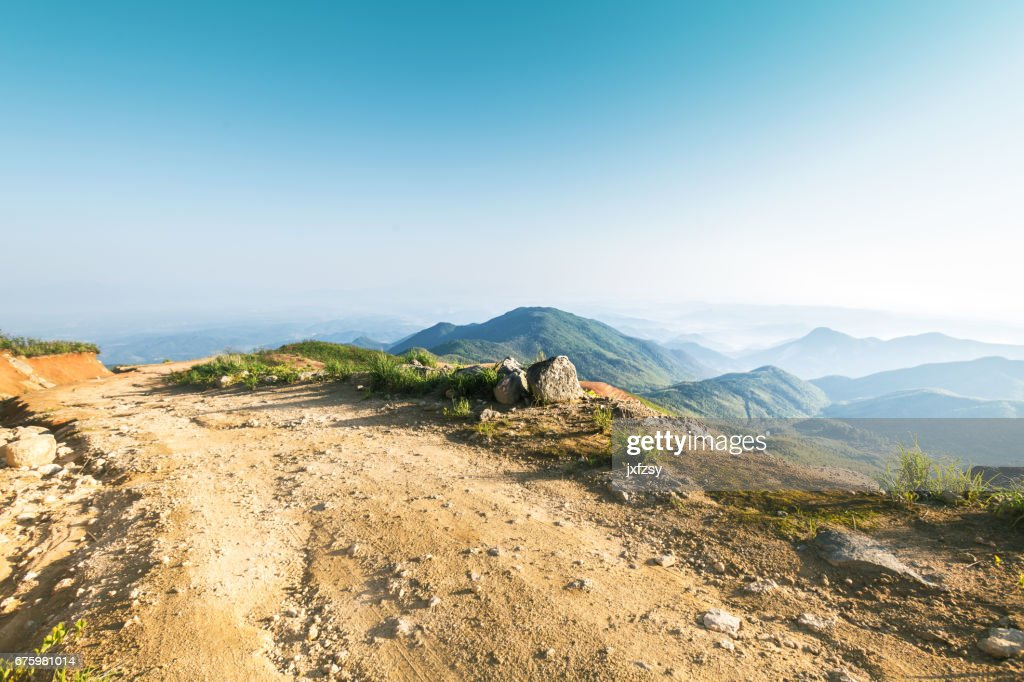 rock stone road in sunrise with tire imprint for automobile commercial : Stock Photo