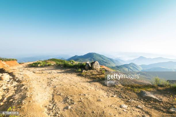 rock stone road in sunrise with tire imprint for automobile commercial - track imprint stock photos and pictures