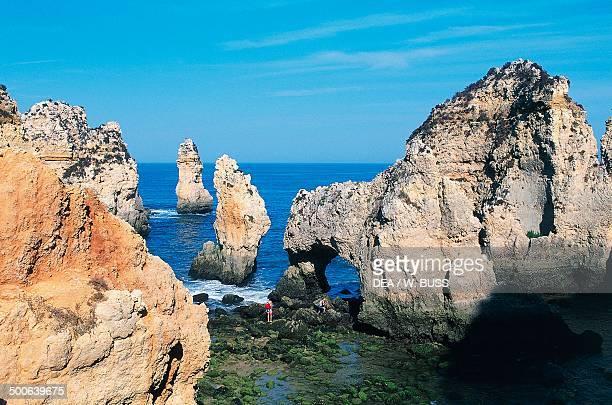 Rock walls cliffs and natural arch of Ponta da Piedade Algarve Portugal