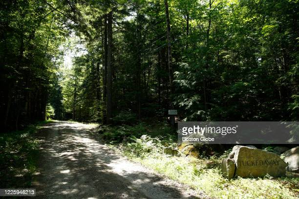 """Rock with the words """"Tucked Away"""" is seen at the foot of the driveway where Ghislaine Maxwell was staying in Bradford, NH on July 7, 2020. Maxwell..."""