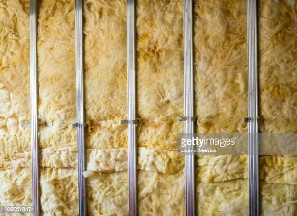 rock wool of an home wall - isoliert stock-fotos und bilder