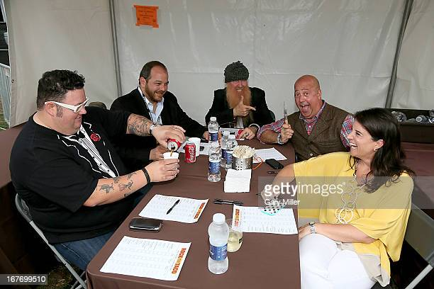Rock Your Taco judges Graham Elliot Andy Langer Billy Gibbons Andrew Zimmern and Christina Gordavic at the judges table during the Austin Food Wine...