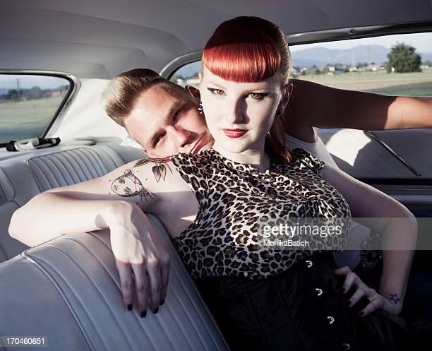 rockabilly couple in a car